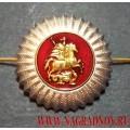 Кокарда серебряного цвета Государственных служб Москвы