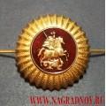 Кокарда золотого цвета Государственных служб Москвы